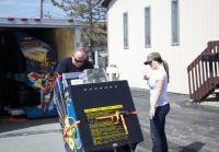Customer Unloads Arcade machines