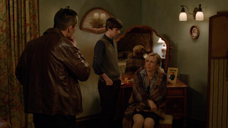 Sheriff Romero listens to Norma