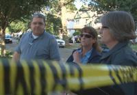 Cleveland detectives wait outside crime scene
