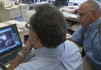 Detectives watch surveillance footage