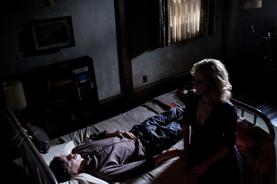 Norma goes to Norman's bedside