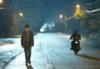 Dylan follows Norman by motorcycle