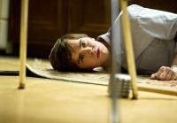 Norman Bates lies on kitchen floor