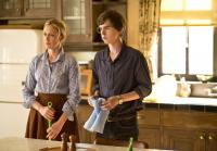 Norma and Norman clean kitchen