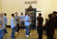 Teens stand in front of death row