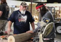 Godwin and Jep work on giant duck call