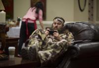 Willie checks phone at camo shoot