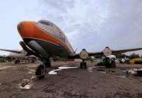 Chris and Robbie load plane's fuselage