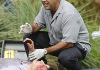 Sanchez examines Douglas Packard's body