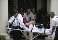 Paramedics rush Chapman to hospital