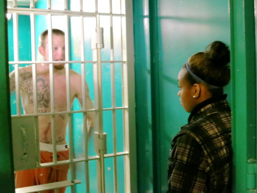 Maykala comes face to face with an inmate.