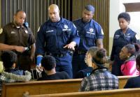Officers speak to the teens.