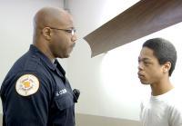 Officer Shane Collins speaks to James.