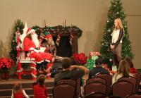 Korie introduces Santa and his elf in camo