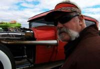 Marc checks rust on hot rod