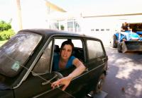 Jennifer Loading Car